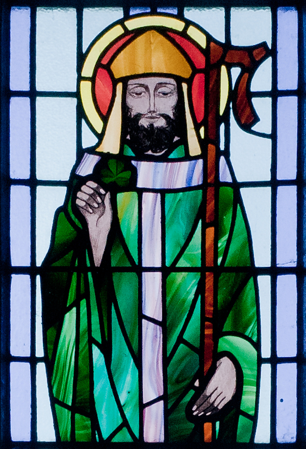 Saint Patrick depicted in a stained glass window at Saint Benin's Church, Ireland