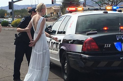 Bride on the way to her Wedding Arrested.